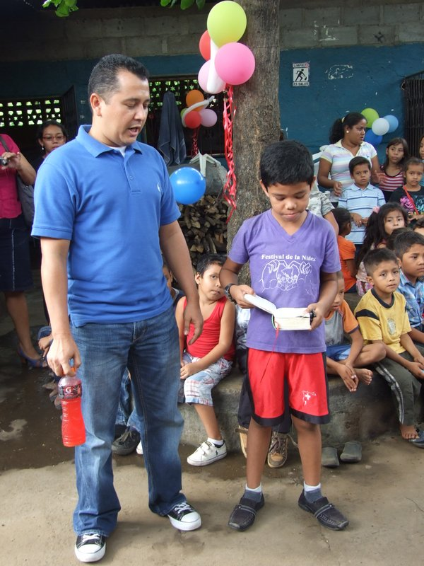 A boy welcoming us to the second Managua program reading to us from his Bible with Mario translating
