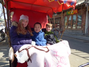 Rinnah, Noah, and Toby in the rickshaw