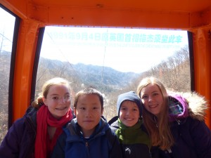 Kids on the cable car up to the Great Wall