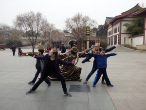 Our kids having fun with the statues in the park