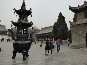 The entrance to the Wild Good Pagoda - look at the size of the burner next to the women!