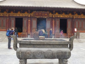 The incense burning outside one of the idol's halls.