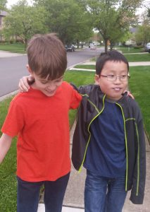 Noah and Toby walking in the neighborhood - they both are (almost always) enjoying having a brother.