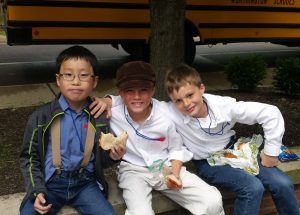 Noah with some friends on his first field trip - he had to dress like a pioneer and he had no idea what that was.