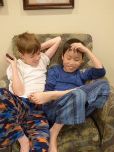 Brothers hanging out in their PJ's before church.