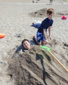 Noah learning what it means to have siblings and Toby loving it - they took turns burying each other all afternoon.