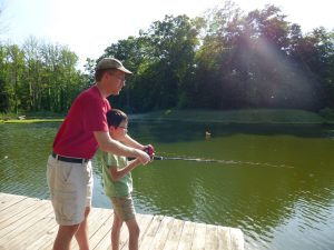 Noah trying fishing for the first time at Doctor Dan and Stevie's lake