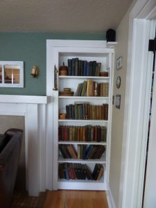 The innocuous looking bookcase in the living room