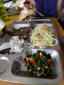 Our lunch at the orphanage - whole fish, rice, congee, shredded spicy potato, greens, and steamed buns.