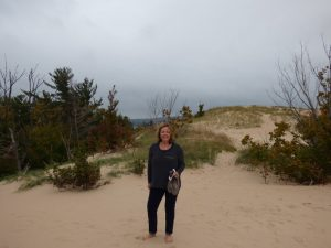 Chris on the dunes with Lake Michigan behind her